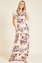 Short sleeve soft blush and floral print long maxi dress. Scoopneck and has pockets