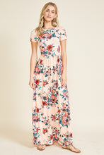 Short sleeve soft blush and floral print long maxi dress. Scoopneck and has pockets. perfect for any occasion