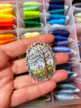 Embroidered tree and wildflowers brooch