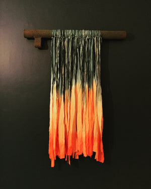 Hand painted silk suspended on rusty reclaimed industrial machinery.