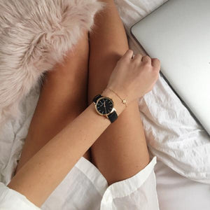 Bauering classic gold, black dial women's watch with finished genuine black leather strap. Perfect accessory to match jewelry and accessories. Online exclusive at BAUERING.