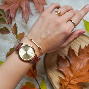 Classic gold women's watch with gold sunray dial and finished genuine brown leather strap. Perfect accessory to match jewelry and accessories.