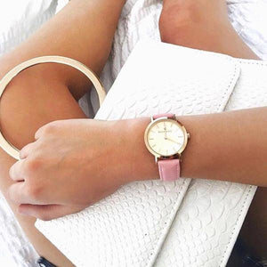 Classic rosegold women's watch with classic dial and finished genuine pink leather strap. Perfect accessory to match jewelry and accessories.