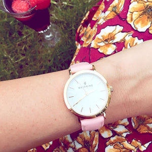 Classic stainless steel women's watch with genuine pink leather strap. Perfect accessory to match jewelry and accessories.
