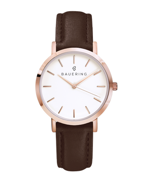 Classic rosegold women's watch with classic dial and finished genuine brown leather strap. Perfect accessory to match jewelry and accessories.