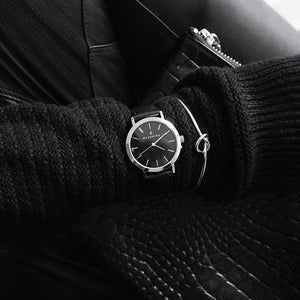 Classic black dial stainless steel ladies watch with genuine black leather strap. Perfect accessory to match silver jewellery and black sweater.