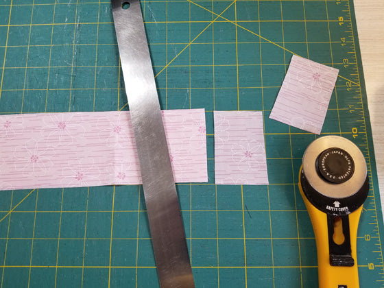 Measuring and cutting fabric