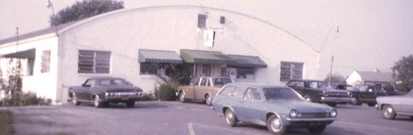 Old photo of Good's Store with cars parked in the front