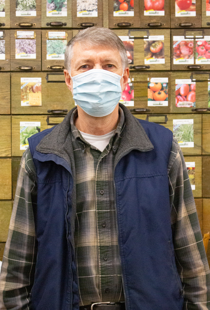 Man in seed room