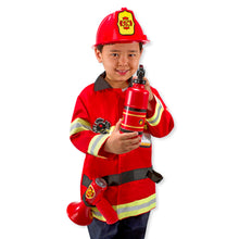 Child wearing fireman costume