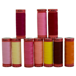 Mettler Thread in Assorted warm color shades.