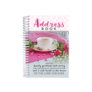 Spiral-bound address book with teacup on front cover.