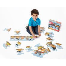 Boy putting puzzle together