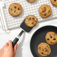 Moving cookies with spatula.