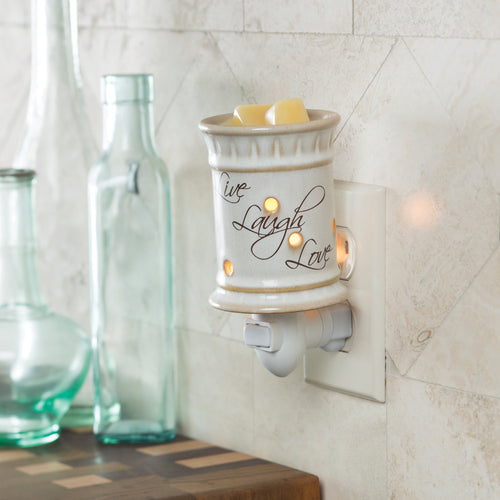 Wax warmer that plugs into the wall.