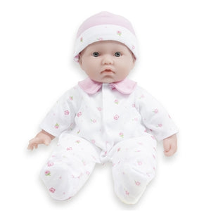 La Baby Soft doll dressed in a pink and white sleeper and hat.
