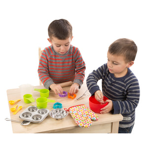Children playing with baking set