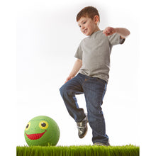 Boy playing with kickball.