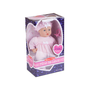 Melissa and Doug Jenna Doll wearing pink outfit inside box.