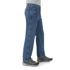 Antique Indigo Relaxed Fit Wrangler blue jeans, side view.
