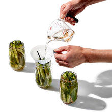 Using funnel to fill pickle jars