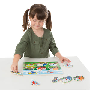Girl putting together peg puzzle
