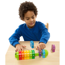 Child using Counting Caterpillar toy