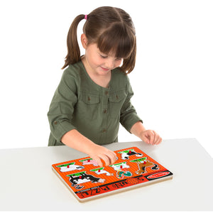 Girl putting puzzle together