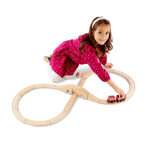 Girl playing with train set