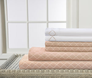 Oat Color Bed sheets with white pillows cases.