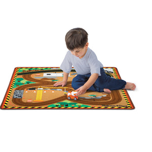 Child playing on Melissa & Doug construction zone rug.