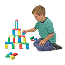 Boy playing with block set.