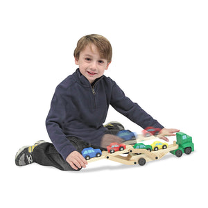 Boy playing with car carrier toy