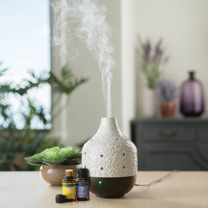 Botanical Large Essential Oil diffuser with essential oils.