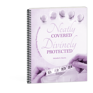 Neatly Covered, Devinely Protected book by Michelle R. Martin 9780878137732