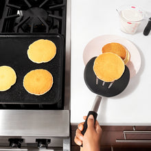 Pancake turner in use