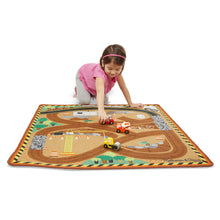 Child playing on rug.