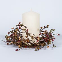 Burnt Red, teal, tan rice berry candle ring.
