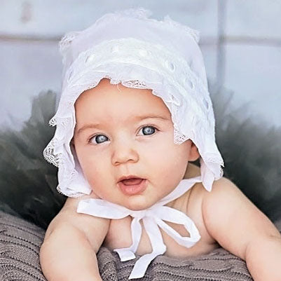 Little girl wearing White Ribbon Baby Bonnet