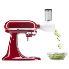 Mixer with attachment.