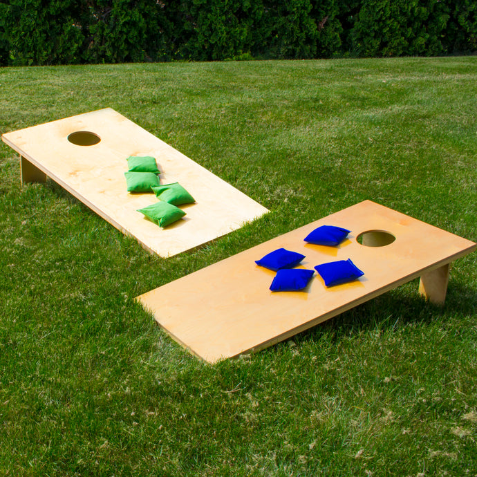 Cornhole game in lawn