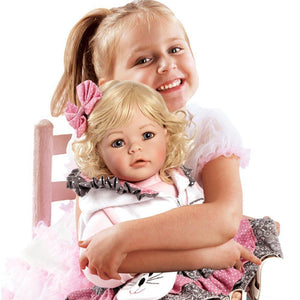 Toddler Time Doll The Cat's Meow Little girl holding doll