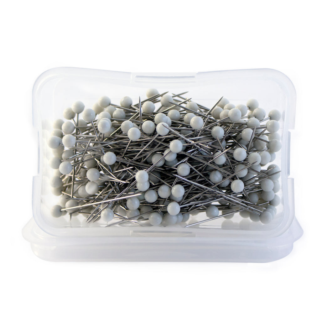 250 Dritz pins with white ball heads.