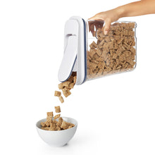 OXO cereal dispenser in use.