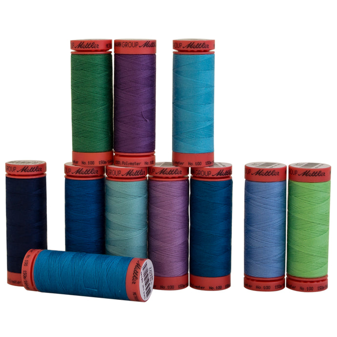 Mettler Metrosene polyester thread in assorted cool colors.