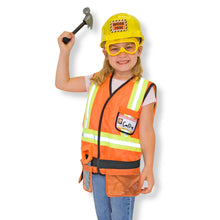 Girl wearing construction work costume