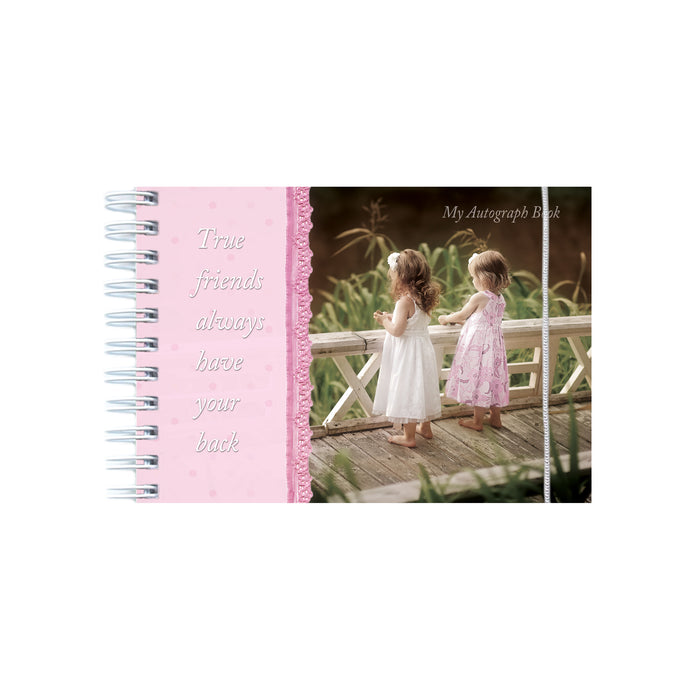 Autograph book with photo of two girls standing on a bridge.