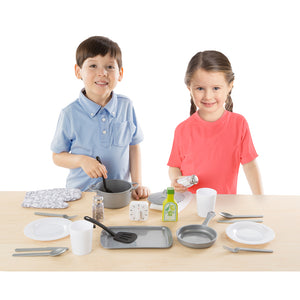 Boy and girl playing with kitchen set