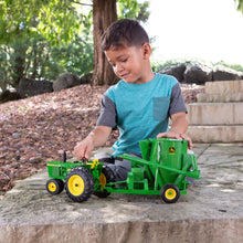 Boy playing with tractor
