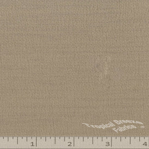 Tan solid color fabric